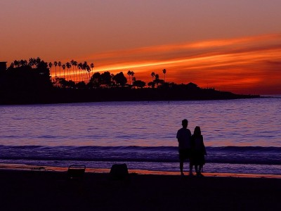 2476-a-couple-on-the-beach-during-sunset-pv